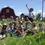 day camp kids infront of barn  hands up (2)